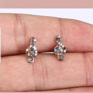 Multi gem treble clef gold earring studs